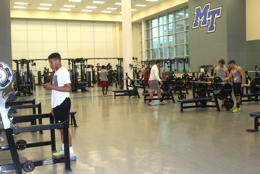 Students using the weight room at the Recreation Center in between classes. (Photo: Emily Austin)